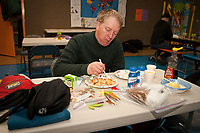 Jeff Holt eats a free breakfast at the Nikolai school during Iditarod 2009