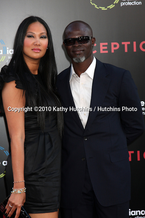 LOS ANGELES - JUL 13:  Kimora Lee Simmons & Djimon Hounsou arrive at the Inception Premiere at Grauman's Chinese Theater on July13, 2010 in Los Angeles, CA ....