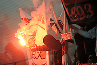 FUSSBALL   DFB POKAL   SAISON 2011/2012  ACHTELFINALE  21.12.2011 VfB Stuttgart - Hamburger SV Die  Cannstatter Kurve brennt, VfB Stuttgart Ultra Fan mit Maske und einer bengalischen Fackelnzu Beginn der 2. Halbzeit