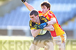 Kieran Ward, Dr. Crokes in action against Tom King, in the All Ireland Senior Club Semi Final at Portlaoise on Saturday.