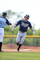 Tampa Bay Rays minor league outfielder Thomas Milone (27) shakes hands with Tim Parenton (8) while running the bases after hitting a home run during an extended spring training game against the Boston Red Sox on April 16, 2014 at Charlotte Sports Park in Port Charlotte, Florida.  (Mike Janes/Four Seam Images)