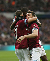 West Ham United's Javier Hernandez celebrates scoring his side's third goal with Aaron Cresswell and Issa Diop<br /> <br /> Photographer Rob Newell/CameraSport<br /> <br /> The Premier League - West Ham United v Huddersfield Town - Saturday 16th March 2019 - London Stadium - London<br /> <br /> World Copyright © 2019 CameraSport. All rights reserved. 43 Linden Ave. Countesthorpe. Leicester. England. LE8 5PG - Tel: +44 (0) 116 277 4147 - admin@camerasport.com - www.camerasport.com