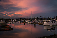 While the sun set in the west, the sky to the northeast blossomed with color that, in turn, was reflected in the still waters of the San Leandro Marina along the eastern shores of San Francisco Bay.