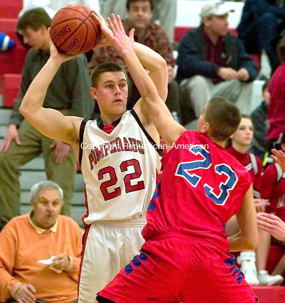 SOUTHBURY, CT-- 31  JANUARY 2008--013108JS1-Pomperaug's Chris Comeau looks to pass while guarded by Berlin's Steve Glowiak (23) during their game Thursday at Pomperaug High School. <br /> Jim Shannon/Republican-American