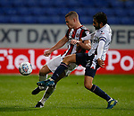 Paul Coutts of Sheffield Utd tussles with Jem Karacan of Bolton Wanderers during the Championship match at the Macron Stadium, Bolton. Picture date 12th September 2017. Picture credit should read: Simon Bellis/Sportimage