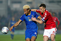 Lyle Taylor of AFC Wimbledon and Jason Pearce of Charlton Athletic tussle for the ball during the Sky Bet League 1 match between AFC Wimbledon and Charlton Athletic at the Cherry Red Records Stadium, Kingston, England on 10 April 2018. Photo by Carlton Myrie / PRiME Media Images.