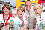Margaret O'Sulivan, Mary O'Hanlon and young Kieran Feeley, with Miche?al O'Coilea?in and Jackie Barrett at the Listowel Tidy Towns Waste Management Stall in the Farmer's Market last Friday morning.   Copyright Kerry's Eye 2008
