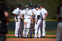 Dartmouth Big Green head coach Bob Whalen (2) talks with his team including (clockwise) catcher Kyle Holbrook (9), third baseman Blake Crossing (13), shortstop Nate Ostmo (19), pitcher Cole O'Connor (33), second baseman Dustin Shirley (6), and first baseman Michael Ketchmark (27) during a game against the St. Bonaventure Bonnies on February 25, 2017 at North Charlotte Regional Park in Port Charlotte, Florida.  St. Bonaventure defeated Dartmouth 8-7.  (Mike Janes/Four Seam Images)