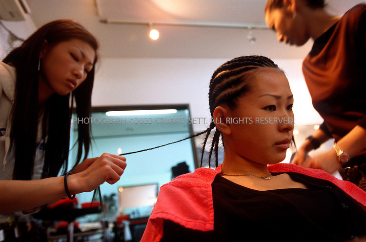 5/18/2002--Tokyo, Japan..Eriko Nishizaki (18), getting Afro style cornrows put in at Happy'  a hair salon in Yokohama.....All photographs ©2003 Stuart Isett.All rights reserved.This image may not be reproduced without expressed written permission from Stuart Isett.