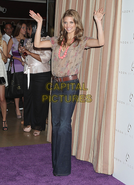 AnnaLynne McCord.'Noon by Noor' Launch Event held at the Sunset Tower Hotel, West Hollywood, California, USA..July 20th, 2011.full length beige pink floral print dress jeans denim wide leg flared hands arms in air waving beads necklace .CAP/ADM/RE.©Russ Elliot/AdMedia/Capital Pictures.