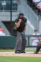 Home plate umpire Brian O'Nora makes a strike call during the International League game between the Pawtucket Red Sox and the Charlotte Knights at BB&T BallPark on July 6, 2016 in Charlotte, North Carolina.  The Knights defeated the Red Sox 8-6.  (Brian Westerholt/Four Seam Images)