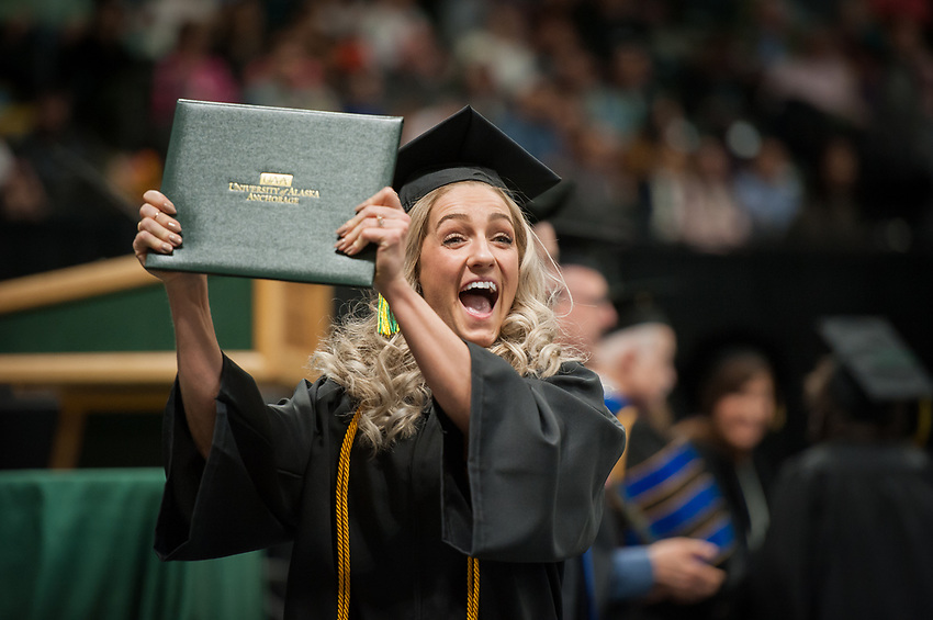 Rachael Neumann, AVTE BS, celebrates after  receiving her degree during the UAA Spring 2018 Commencement at the Alaska Airlines Center.
