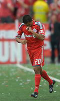 23 May 09: Toronto FC midfielder Amado Guevara #20 kisses his ring after scoring a goal during a game between the New England Revolution and Toronto FC.Toronto FC won 3-1.