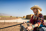 USA, Nevada, Wells, Founder Madeleine Pickens leads a Horse-Drawn Wagon Ride at Mustang Monument, A sustainable luxury eco friendly resort and preserve for wild horses, Saving America's Mustangs Foundation