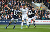 Leeds United's Mateusz Klich gets in between Millwall's Jayson Molumby and Ryan Leonard<br /> <br /> Photographer Rob Newell/CameraSport<br /> <br /> The EFL Sky Bet Championship - Millwall v Leeds United - Saturday 5th October 2019 - The Den - London<br /> <br /> World Copyright © 2019 CameraSport. All rights reserved. 43 Linden Ave. Countesthorpe. Leicester. England. LE8 5PG - Tel: +44 (0) 116 277 4147 - admin@camerasport.com - www.camerasport.com