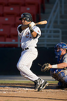 Ronald Pena (40) of the Hickory Crawdads follows through on his swing versus the Columbus Catfish at L.P. Frans Stadium in Hickory, NC, Wednesday, May 21, 2008.