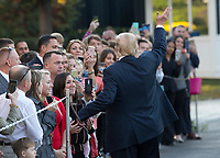 United States President Donald J. Trump greets well wishers before departing the White House in Washington, DC, November 3, 2017 for a multi-day trip to Hawaii and then on to Asia.<br /> Credit: Chris Kleponis / CNP /MediaPunch