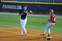 2 March 2012:  FIU pitcher Mason McVay (27) threatens to throw after a runner after beating Brown's Mike DiBiase (24) to first as the FIU Golden Panthers defeated the Brown University Bears, 6-5, at University Park Stadium in Miami, Florida.