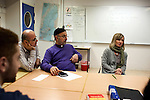Left to right, Iraqi Saad Shamoon Moshi, Syrian Father Stefan Ayoub, and Swedish teacher Marie Silén in the Swedish language class for immigrants in Södertalje, Sweden, Nov. 6, 2014. Södertalje is known for its open-door policy toward refugees, especially mostly Christian Syrians and Iraqis, who make up 30,000 of the town's 90,000 residents. Since the Syrian war began three years ago, the town has seen a marked increase in Syrian refugees resettling in Södertalje, and seeking housing, education, and other services.