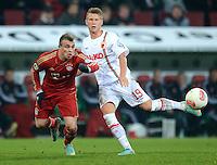 FUSSBALL  DFB-POKAL  ACHTELFINALE  SAISON 2012/2013    FC Augsburg - FC Bayern Muenchen        18.12.2012 Xherdan Shaqiri (li, FC Bayern Muenchen) gegen Matthias Ostrzolek (FC Augsburg)