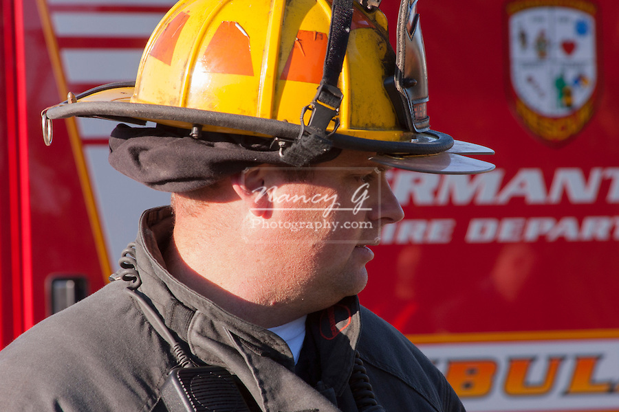A firefighter in front of the Germantown Fire Department ambulance