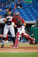 Clearwater Threshers catcher Edgar Cabral (30) throws to second base in front of Riley Mahan (2) during a game against the Jupiter Hammerheads on April 9, 2018 at Spectrum Field in Clearwater, Florida.  Jupiter defeated Clearwater 9-4.  (Mike Janes/Four Seam Images)