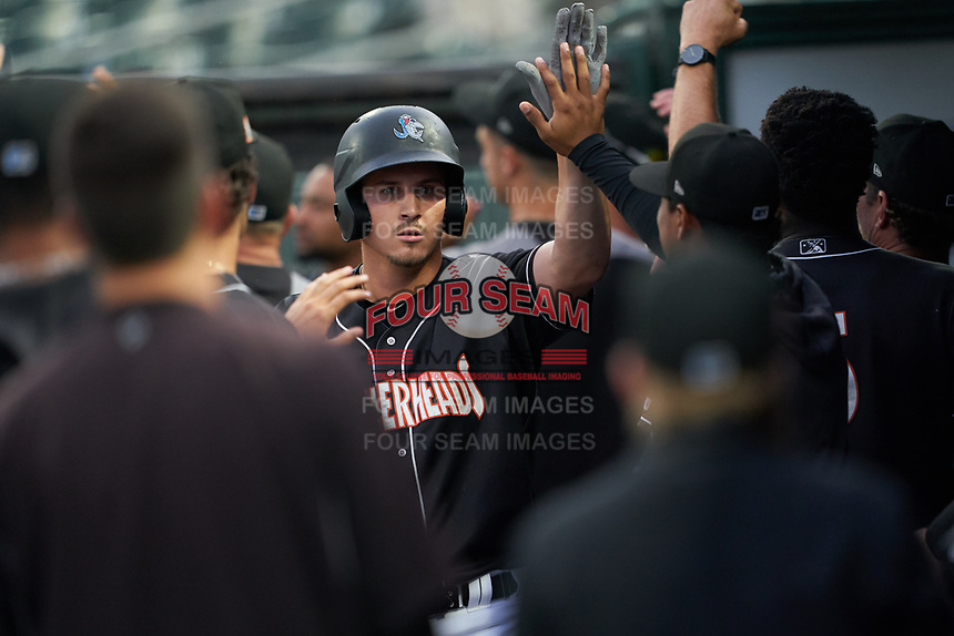 Jupiter Hammerheads JJ Bleday high fives teammates in the dugout after hitting a home run during a Florida State League game against the Lakeland Flying Tigers on August 12, 2019 at Roger Dean Chevrolet Stadium in Jupiter, Florida.  Jupiter defeated Lakeland 9-3.  (Mike Janes/Four Seam Images)