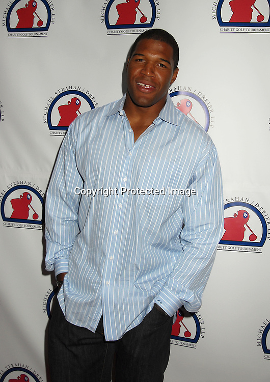 """Michael Strahan..at The Kick-off Party for the Strahan/Dreier LLP Charity..Golf Tournament on July 9, 2006 at TAO. The tournament ..will benefit the """"Take The Field"""" Charity and """"Student Sponsors Partners""""...Robin Platzer, Twin Images"""