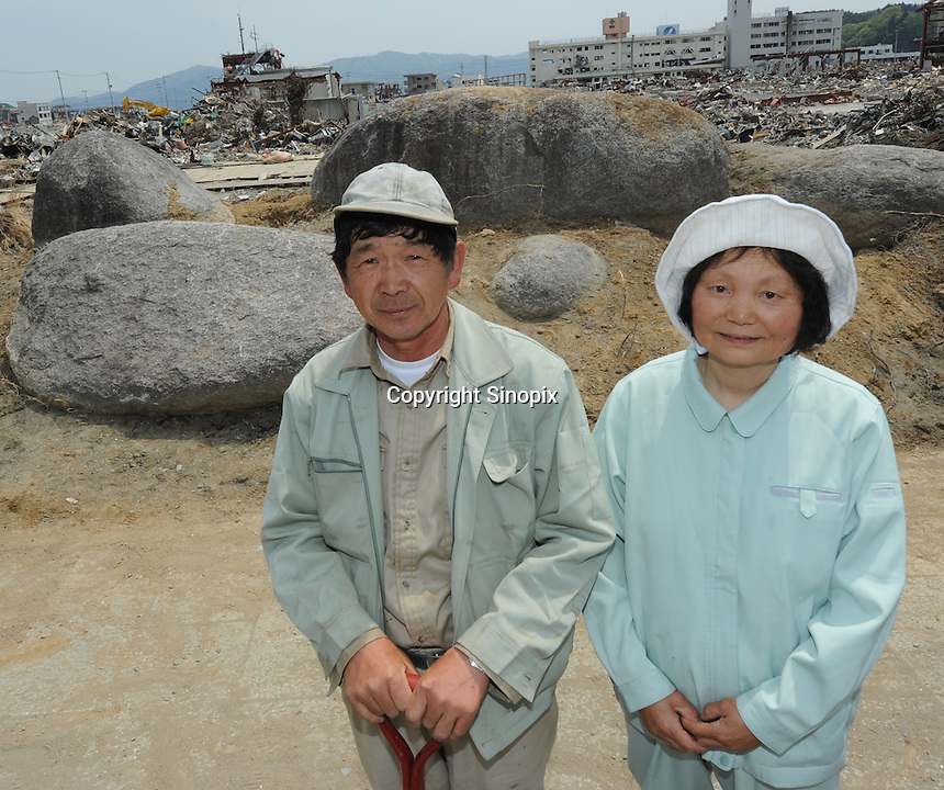 Mr Katsu Kura with his wife (pictured) and some volunteers  cleared all the debris and from the Se Se Ragi stone park he built 22 years ago in  the center Minamisanriku, Myiagi, Japan.The fishing port of Minamisanriku, Miyagi, Japan where the popultion was reduced from 18,000 to about 8,000 when 10,0000 where washed out to sea.<br /> <br /> Photo by Richard Jones/ Sinopix