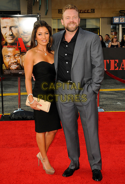 "GUEST & JOE CARNAHAN .arriving at the  20th Century Fox premiere of ""The A-Team"" at Grauman's Chinese Theatre in Hollywood, California, USA, June 3rd 2010..full length grey gray suit black dress strapless .CAP/ROT.©Lee Roth/Capital Pictures"