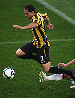 Phoenix's Leo Bertos beats a tackle during the A-League football match between Wellington Phoenix and Perth Glory at Westpac Stadium, Wellington, New Zealand on Sunday, 16 August 2009. Photo: Dave Lintott / lintottphoto.co.nz