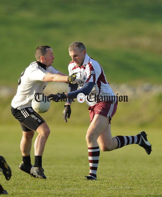 Ciaran Devitt of Ennistymon in action against Brian Considine of Liscannor during their Cusack Cup game at Liscannor. Photograph by John Kelly.