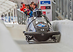 9 January 2016: United States of America pilot Nick Cunningham leads his 4-man team as they cross the finish line after their second run of the day at the BMW IBSF World Cup Bobsled Championships at the Olympic Sports Track in Lake Placid, New York, USA. Cunningham's team came in 9th for the day, with a 2-run combined time of 1:50.72. Mandatory Credit: Ed Wolfstein Photo *** RAW (NEF) Image File Available ***