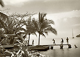 PANAMA, children playing on a pier, Portobello (B&W)