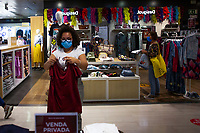 LISBON, PORTUGAL JUNE 15:  A store employee its seen folding clothes inside El Corte Ingles Mall in Lisbon, on June 15, 2020. A delay on the planned reopening of malls in the Lisbon region has been reported after recording new clusters of the coronavirus outbreak. (Photo by Luis Boza/VIEWpress)