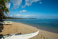 Hawaiian outrigger canoes on Waimanalo Beach with Kane'ohe in the distance, Windward O'ahu.