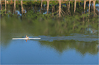 From the top of a high rise in the Austin skyline, I used a telephoto lens to capture this image of a single rower gliding over the surface of Lady Bird Lake near the shores of Zilker Park.