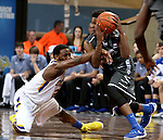 SIOUX FALLS, SD - DECEMBER 27:  Tevin King #2 from South Dakota State University reaches in and grabs the arm of Aldonis Foote #15 from Middle Tennessee State in the first half of their game at the Sanford Pentagon December 27, 2015 in Sioux Falls, South Dakota. (Photo by Dave Eggen/Inertia)