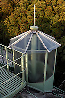 Tropical Rainforest Glasshouse (formerly Le Jardin d'Hiver or Winter Gardens), 1936, René Berger, Jardin des Plantes, Museum National d'Histoire Naturelle, Paris, France. Detail of the glass and metal turret on the roof of the Art Deco style glasshouse with the leafy tops of the trees in the Jardin des Plantes in the background.