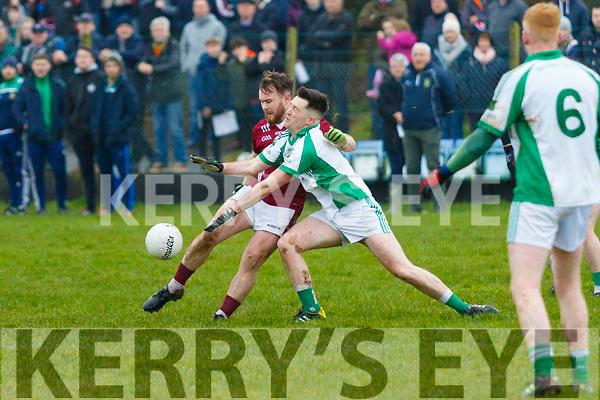 Robert O'Grady, Ballybrown, blocks down a shot from Mikey Houlihan, Cromane, in the Munster Junior B Club Football Final in Knockaderry