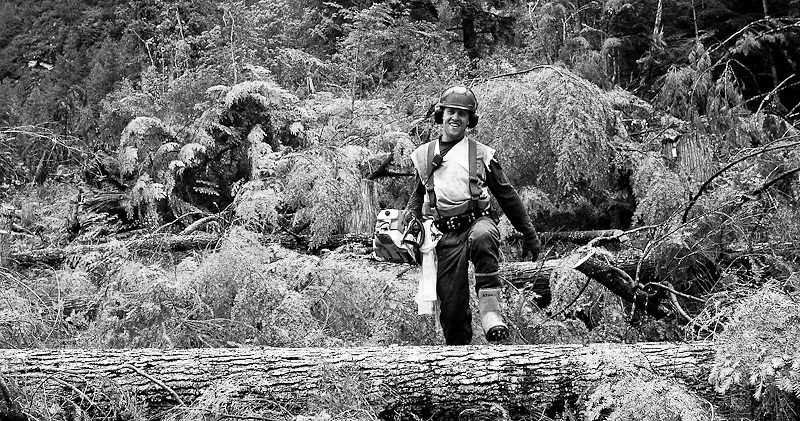 """Jordon Hoptin was a """"hooktender in training,"""" also called a """"striprunner"""" in heli logging. here in Heilifor's Bute Inlet operation. Effectively, Jordan was a chokerman learning the ropes. Like a number of young people who are first attracted to the wages and lifestyle of the industry, Jordan has since left the industry due to instability."""