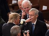 United States President Donald J. Trump chats with US Senators Orrin Hatch (R-UT) (rear), John Cornyn (R-TX)(center) and Senate Majority Mitch McConnell (Republican of Kentucky) after addressing a joint session of Congress on Capitol Hill in Washington, DC, February 28, 2017. Credit: Chris Kleponis / CNP