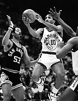 Warrior Perry Moss with San Antonio's Artis Gilmore #53<br />