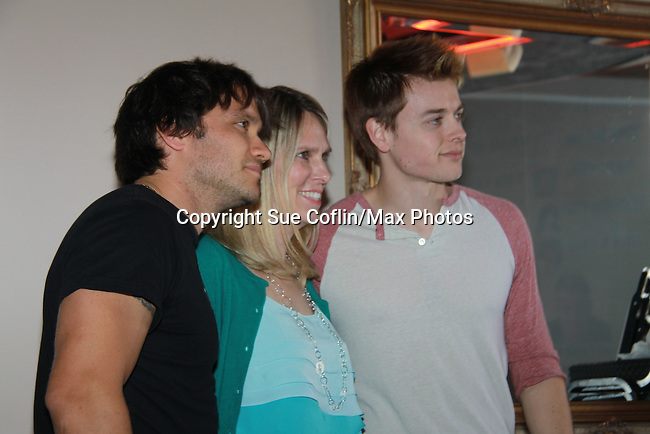 "A Fan with General Hospital's Dominic Zamprogna ""Dante"" and Chad Duell ""Michael"" join fans on February 19, 2012 at Uncle Vinnie's Comedy Club, Point Pleasant, New Jersey. (Photo by Sue Coflin/Max Photos)"