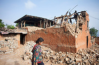 A girl in front of her destroyed house near Kathmandu, Nepal. May 1, 2015 . May 1, 2015