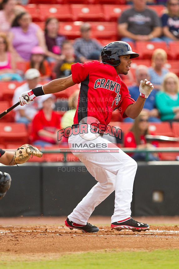 Nick Williams (1) of the Hickory Crawdads follows through on his swing against the Kannapolis Intimidators at L.P. Frans Stadium on May 25, 2013 in Hickory, North Carolina.  The Crawdads defeated the Intimidators 14-3.  (Brian Westerholt/Four Seam Images)