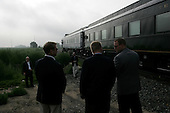 Lamar, Colorado.USA.August 7, 2004..Democratic Presidentual nominee Sen. John Kerry and VP nominee Sen. John Edwards take a whistle stop tour through the south western US states. The train stops just outside Lamar for the two to come off the train at dawn with dozens of secret service..