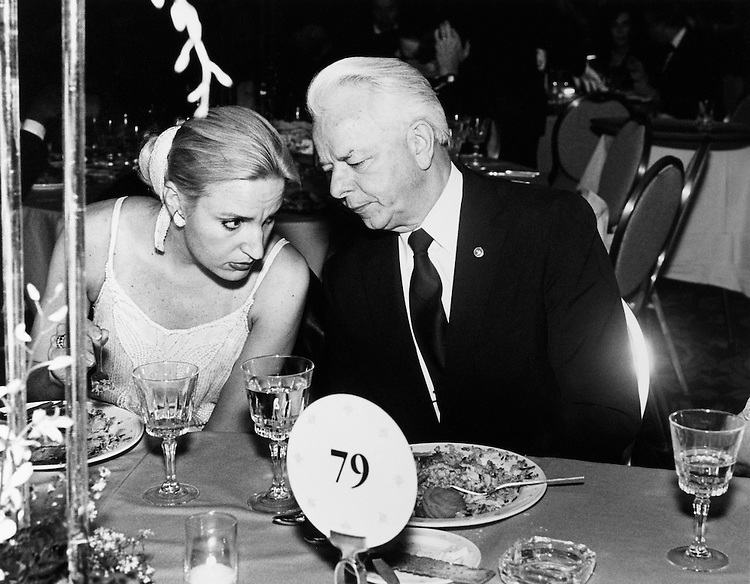 "Christine M. Warnke, D-CO., Democratic State Committee, and Sen. Robert Carlyle ""Bob"" Byrd, D-W.Va. sitting and whispering at dinner. September 1989 (Photo by Laura Patterson/CQ Roll Call)"
