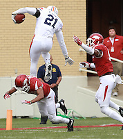 Arkansas Democrat-Gazette/BENJAMIN KRAIN --10/24/2015--<br /> Auburn RB Kerryon Johnson hurdles Arkansas defender Jared Collins on a fourth down play in the second quarter.