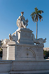 Havana, Cuba; the white marble statue, Fuente de la India, sculpted in 1831 by Giuseppe Gaggini, symbolizing Havana, sits in front of the Parque de la Fraternidad and in the middle of a traffic circle